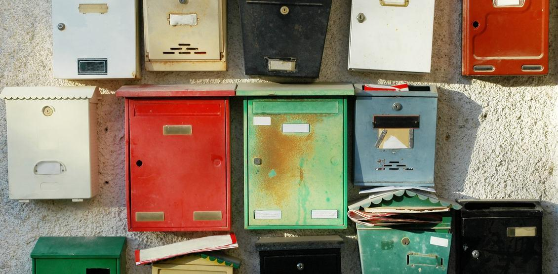 Colorful mailboxes at entrance of apartment buildings -