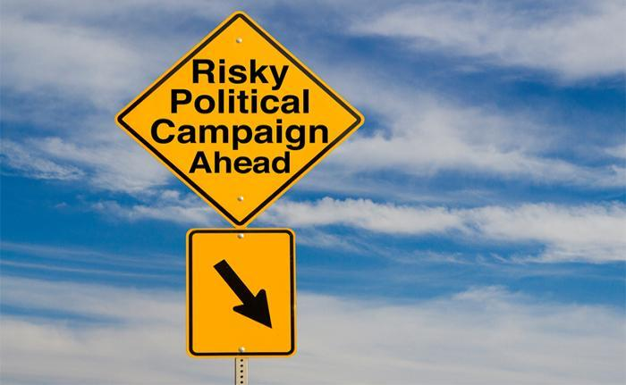 "A sign that says ""Risky Political Campaign Ahead."" Political Advertising"