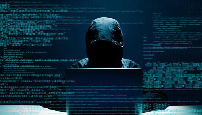 hacker using laptop lurking internet in the dark