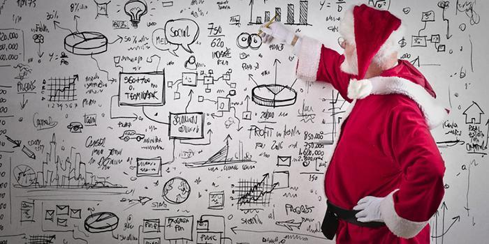 Old man dressed as santa claus calculating and drawing diagrams