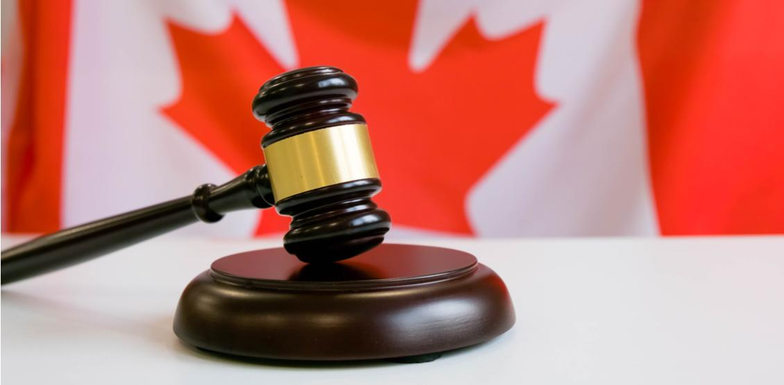 Photo of a judge's gavel in front of a Canadian
