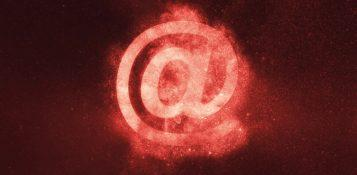 Photo of @ symbol on a red background